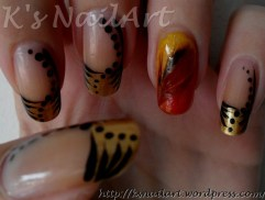 Golden French mani with feather accent